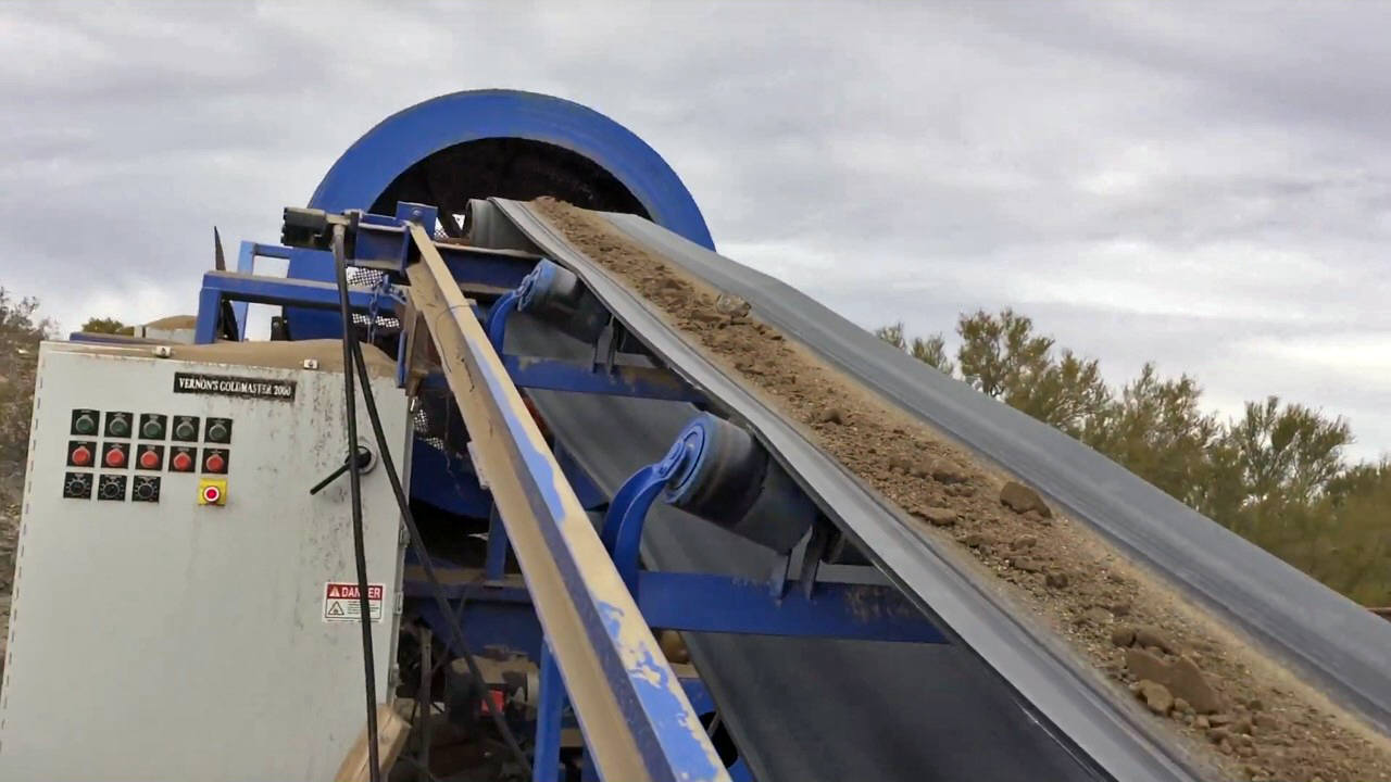 DRYER. 2' x 20' dryer tube. Angle of tube controlled by hydraulic jack. 500,000 BTU waste oil burner with 100 gallon tank Dryer and 17' conveyor driven by hydraulic unit mounted in 10' closed trailer. Dryer mounted on tandem axels with stabilizing jacks.